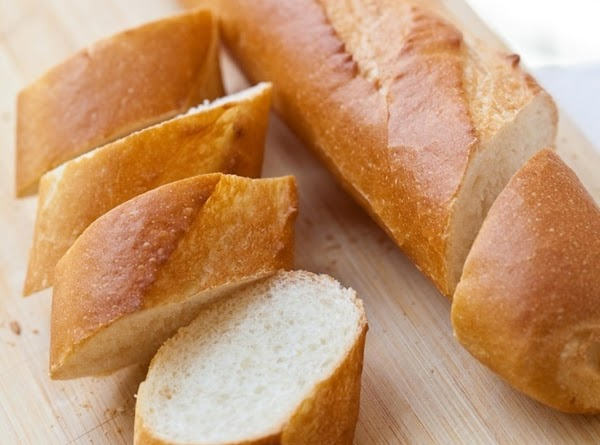 Prepare crostini base:  Slice baguette into 24 1/2 inch slices.  Preheat oven to 350 degrees. Arrange...