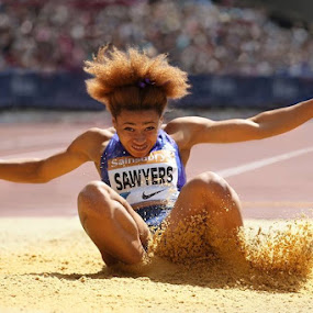 Sand Splash by Ron Russell - Sports & Fitness Running ( sand, splash, female, sport, hair, general, athlete, jump,  )