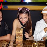 playing Jenga with friends at ON TAP, Taipei in Taipei, T'ai-pei county, Taiwan
