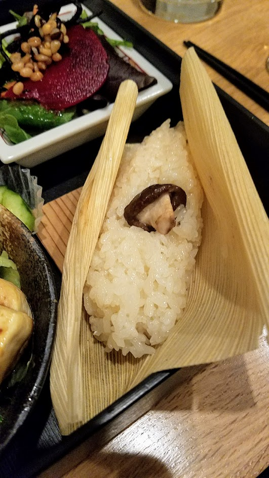 Chef Naoko's Shizuku - a restaurant with natural and organic Japanese cuisine, this is their vegan Shokado, an abbreviated kaiseki meal in a square lacquered box with Ota Tofu Steak and here special stickyish rice from Shizuoka Japan with chestnuts and mushrooms
