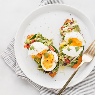 SWEET POTATO AVOCADO TOAST WITH SOFT-BOILED EGG AND GREENS