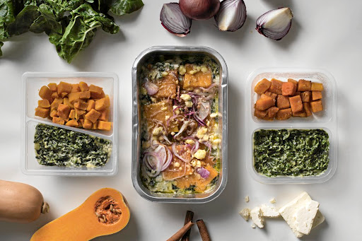 From left: Butternut and creamed spinach side dishes from Woolworths, Checkers and Pick n Pay.