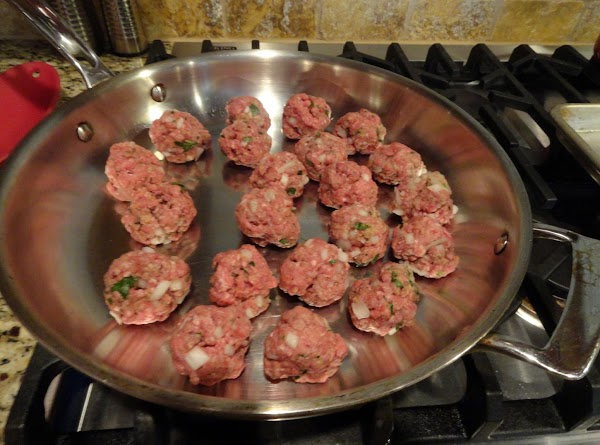 Brown meatballs on all sides, in batches if necessary. Use a slotted spoon to...