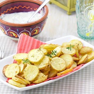 Roasted Rosemary And Thyme Potatoes With Tzatziki Parsley Dip.