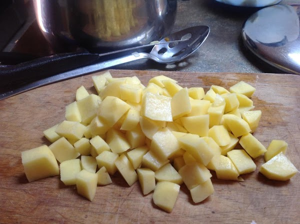 Wash potatoes and add to reserved liquid. Cook over medium high heat till potatoes...