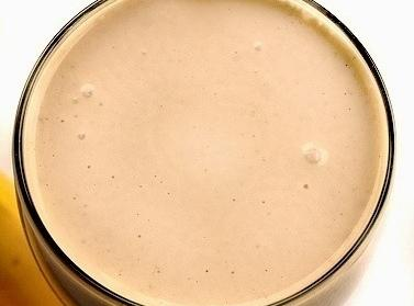 . In blender, combine yogurt, ice, milk, bananas, peanut butter and honey; puree on...