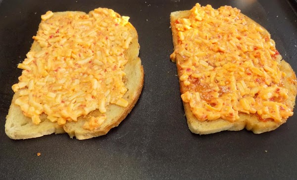 Then, divide the pimento cheese in half and spread on the grilled side of...