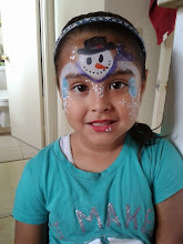 Photo: Christmas face paint design by Bella the Clown. Call to book Bella today at 888-750-7024