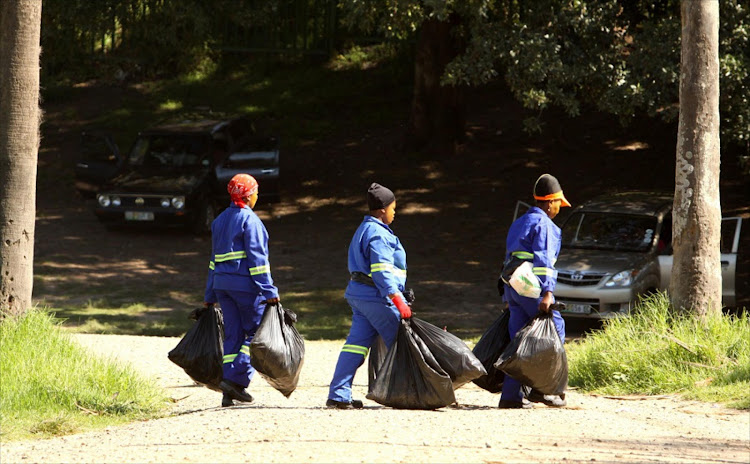Municipal workers clean up Marina Glen in East London.  Picture: DAILY DISPATCH