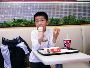 Photo: son was treated with KFC after his companion to visit asylum from where his dad, benzrad 朱子卓 fetched his medicine. its a cloudy day but so busy with actions.