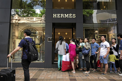 Wait: The Hermès International SCA store on Canton Road in Hong Kong, China. It is difficult even to get on the waiting list for an exclusive Hermès Birkin handbag. Picture: BLOOMBERG
