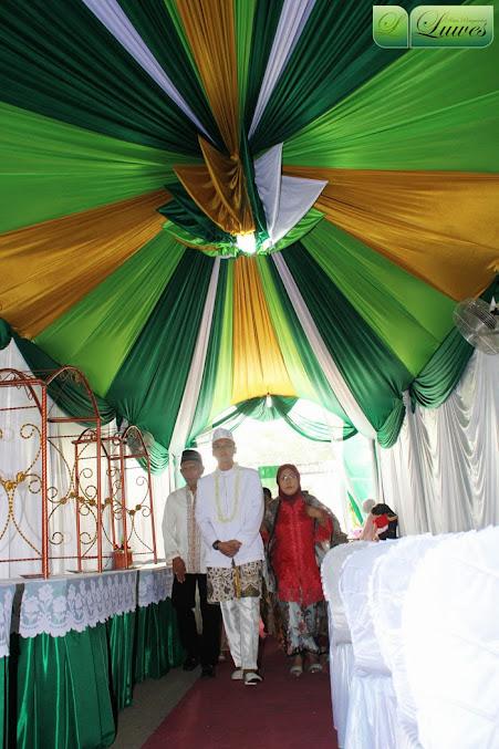 Tenda pernikahan dengan konsep hijau kuning dan putih