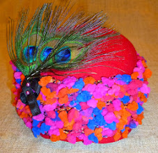 Photo: <KAPELUXE> Unique-Chique Hats by Luba Bilash ART & ADORNMENT  Tomato red wool felt base; hand-crocheted wool; genuine peacock feathers; 360 degree possibilities. Can also be worn on an angle. Size S - 52 cm/20.5 in. $85 SOLD