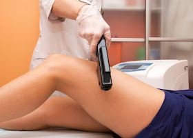 a person having hair removed from their leg through laser treatment