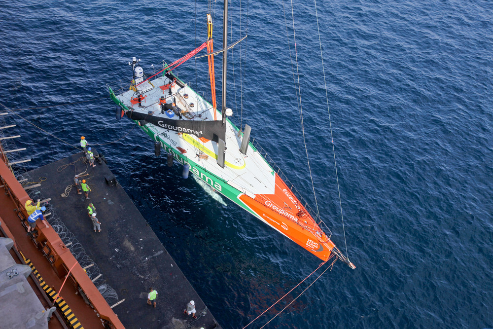 Photo: Groupama Sailing Team unloading in the safe haven port during leg 3 of the Volvo Ocean Race 2011-12, from Abu Dhabi, UAE to Sanya, China. (Credit: Yann Riou/Groupama Sailing Team/Volvo Ocean Race)