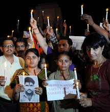 Photo: Amritsar: Sararabjit Singh wife Sukhjit Kaur (C) and daughter Swapandeep Kaur with activists of Akhil Bhartiya Human Rights Organization take out a candle light march to express support for Sarabjit Singh and hisspeedy recovery in Amritsar on Saturday.   PTI Photo by Deepak Sharma(PTI4_27_2013_000163B)