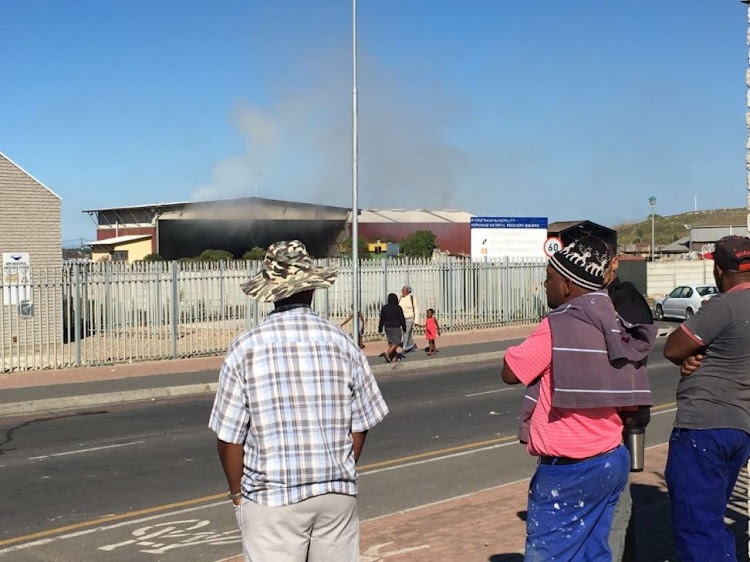 Protests in Hermanus turned fiery over the weekend - as protesters burnt vehicles and a satellite police station.