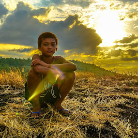 Impassive by Maverick De Castro - Babies & Children Child Portraits ( sun grass kid goldenhour )