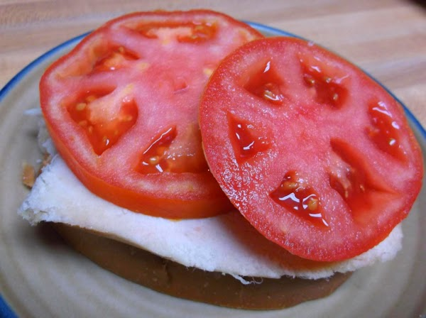 Place half of blotted tomato slices on each.