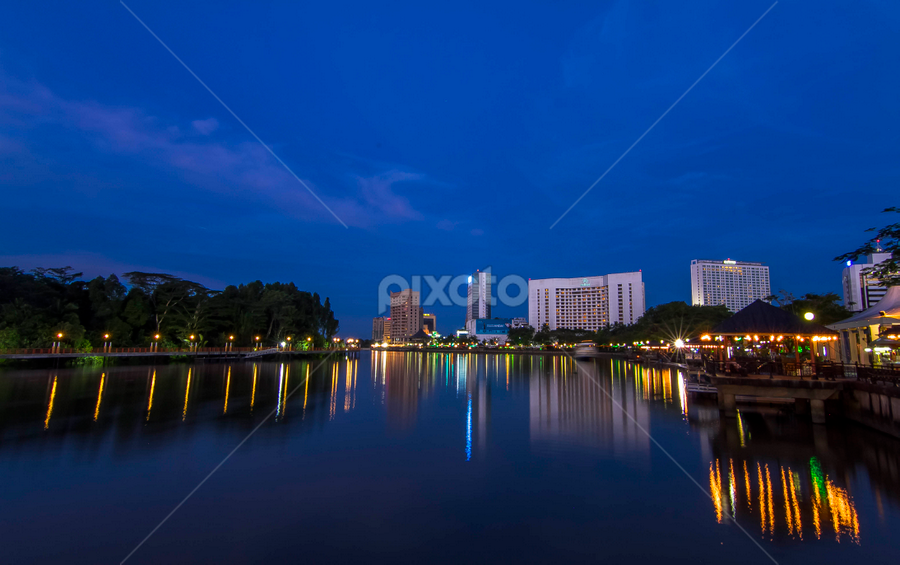 Kuching Waterfront by night. by Victor Sim - Landscapes Starscapes ( lights, vacation, kuching, parks, reflections, travel, cityscape, waterfront, destination, nightscape, river, city )