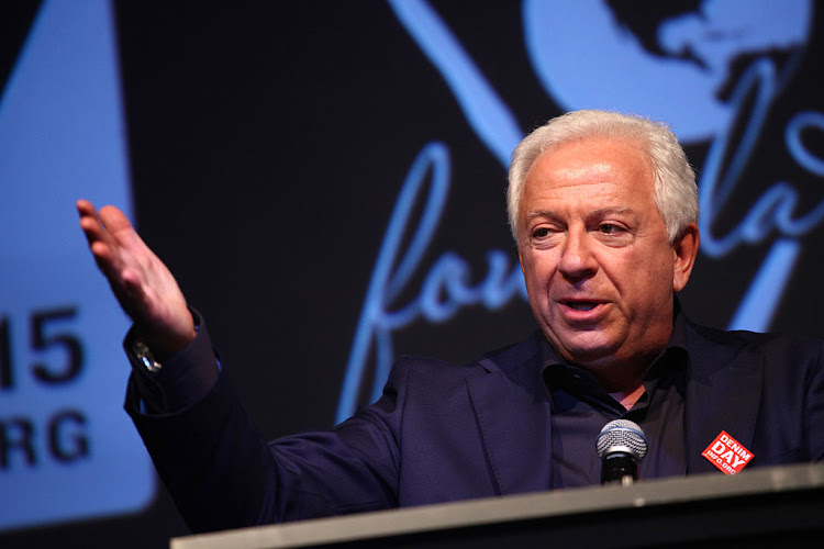 Guess founder Paul Marciano speaks on stage at the GUESS Foundation and Peace Over Violence host 2015 Denim Day celebration at GUESS Headquarters. Marciano resigned on Tuesday in the wake of an investigation into sexual assault claims.