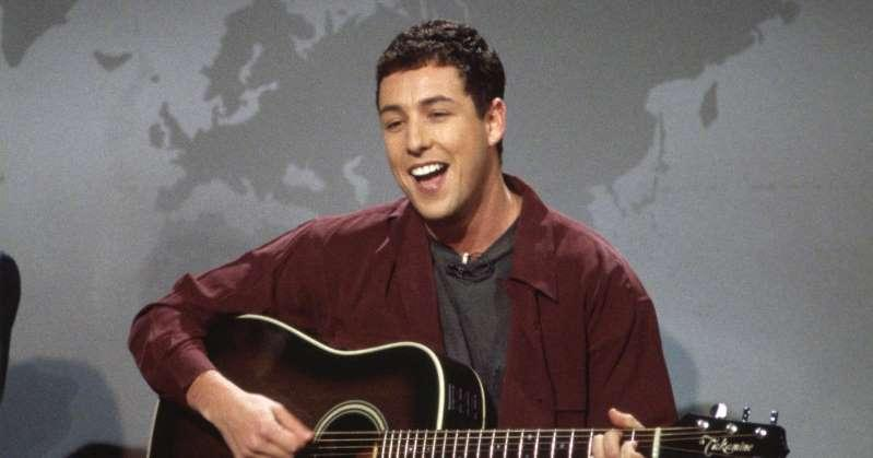 a man holding a guitar: Adam Sandler Recalls Getting Fired from Saturday Night Live: 'I Was Hurt'