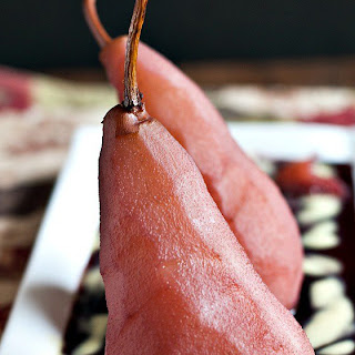Poached Pears in Red Wine with Vanilla Custard Sauce