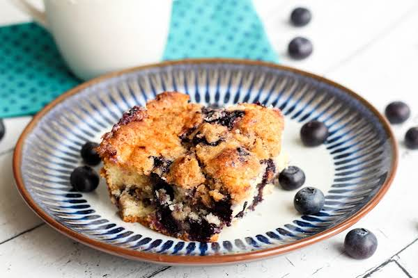 A Slice Of Bang'n Blueberry Coffee Cake On A Plate.