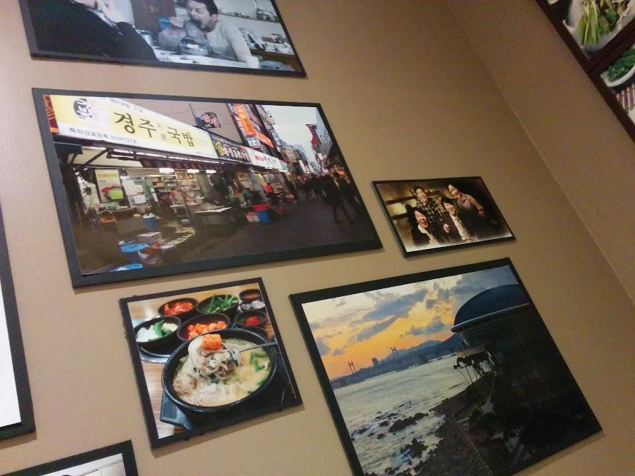 Photos on the wall of Ho Shin Tang on Highway 7