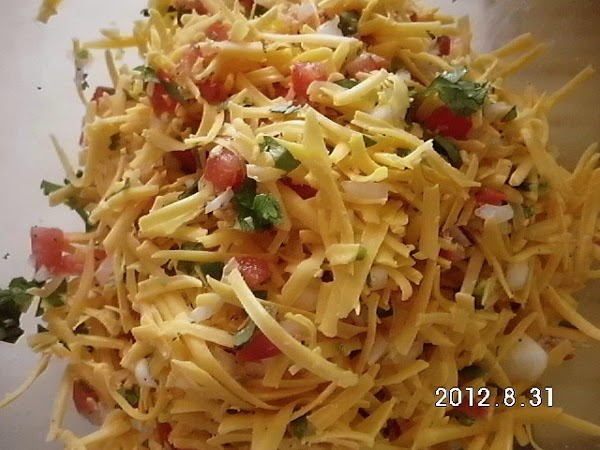 Grate cheese.  Add 2c. of Pico de Gallo to cheese and toss together....