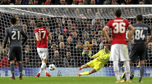 Straight and true: Manchester United's Daley Blind, No17, sends the goalkeeper the wrong way to score from the penalty spot. Picture: REUTERS
