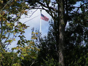 Photo: I walk away from the main area, but chance to have a view of the flag through the trees at the moment that the National Anthem and Taps are played.