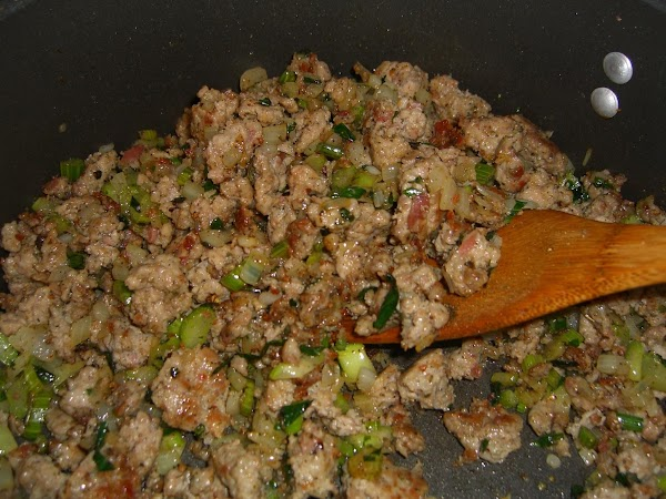 Brown the sausage with the celery, onion and mushrooms.
