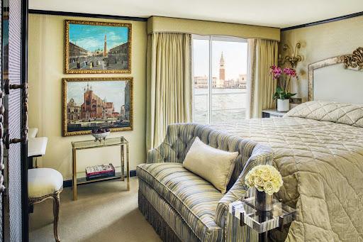 The bedroom of a luxurious suite aboard Uniworld's S.S. La Venezia.