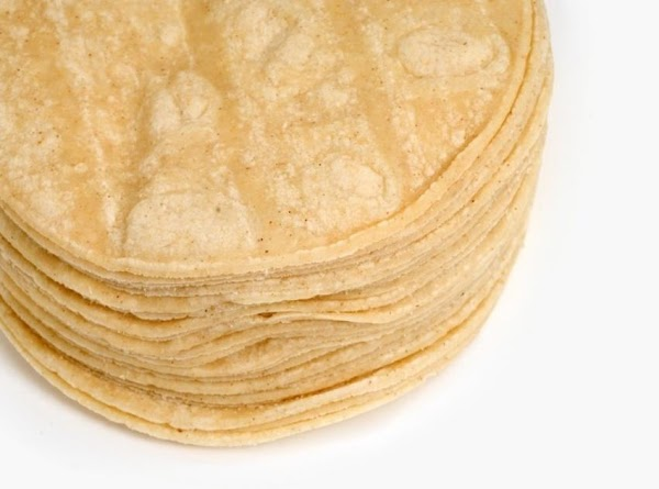 Cut corn tortillas into fourths.