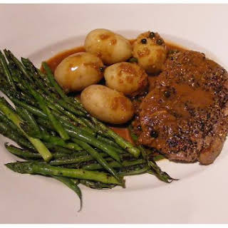 Steak With Peppercorn Cream Sauce.