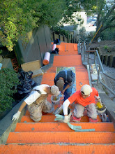 Photo: Third full day of work (October 29, 2013) with KZ Tile workers (left to right: Henry, Ton, and Sing) installing the first sections of the Hidden Garden Steps (16th Avenue, between Kirkham and Lawton streets in San Francisco's Inner Sunset District) 148-step ceramic-tile mosaic designed and created by project artists Aileen Barr and Colette Crutcher. For more information about this volunteer-driven community-based project supported by the San Francisco Parks Alliance, the San Francisco Department of Public Works Street Parks Program, and hundreds of individual donors, please visit our website at http://hiddengardensteps.org.