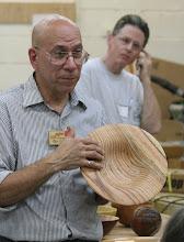 Photo: Mike Colella talks about his oak bowl.