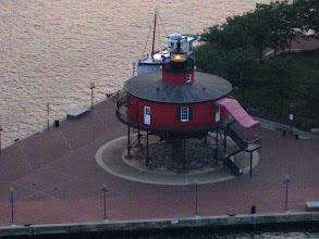 Photo: Screw-in lighthouse, Baltimore Harbor.  This was mounted on 8 posts screwed into the sand, in shallow sea about 12 miles off-shore.  A family lived in the red section.  Beneath, just above the waves, is a small platform for animals and a toilet.