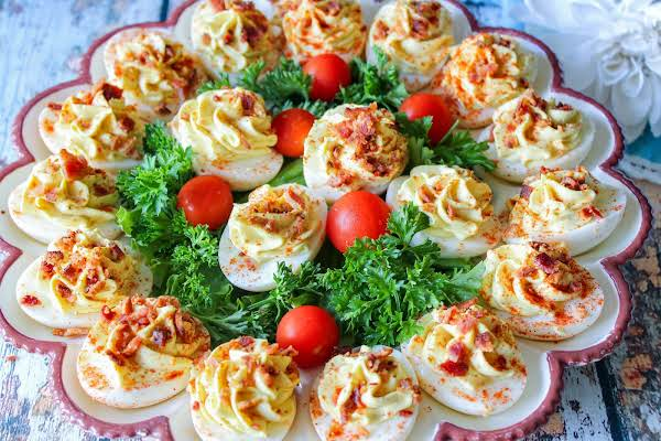 Bacon And Cream Cheese Deviled Eggs On A Platter.