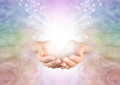 reiki healing hands cupped together and holding light