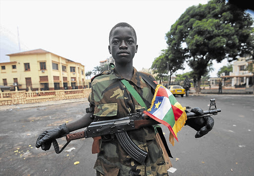 A young Seleka coalition rebel poses near the presidential palace in Bangui this week. Seleka coalition rebels seized the capital Bangui  after the collapse of a two-month-old peace deal with Bozize's regime