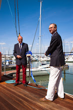 Photo: Island MP Andrew Turner cuts the ribbon and declares the apron open. Commodore Tony Bedingfield looks on. (3rd May 2014)