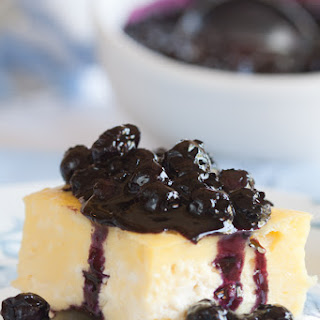 Blintz Souffle With Blueberry Sauce.