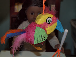 Photo: A pinata.    It's made out of Styrofoam (a ball and a circle) and covered with tissue paper and feathers.  The wings are craft foam and the feet are felt.  We used a low temp glue gun to glue it all together.  http://www.beds-n-blankies.com/howto.htm
