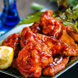 Chicken Wings in Honey-Sriracha Sauce.