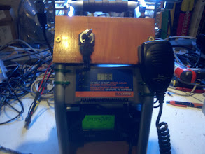 Photo: And here we see the radio running off the battery. I loosened up one of the screws as a mic holder.