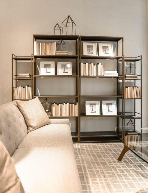Large Bookcase attach in the large wall for the living room
