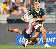 Blitzbok JC Pretorius breaks a tackle against Japan on day 1 of the 2019 HSBC Cape Town Sevens at Cape Town Stadium on Friday.