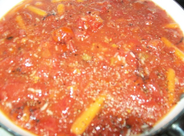 Add the Ro*tel and fire roasted tomatoes, salt, sugar and pepper, water and cook...